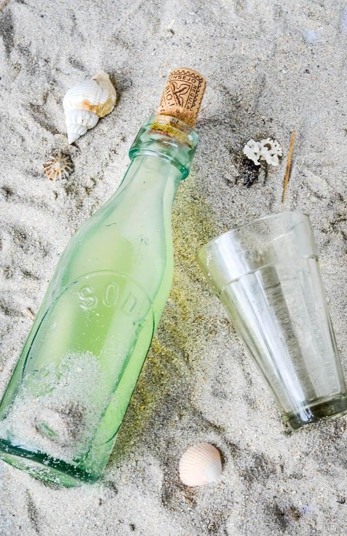 bottle of lemonade on beach