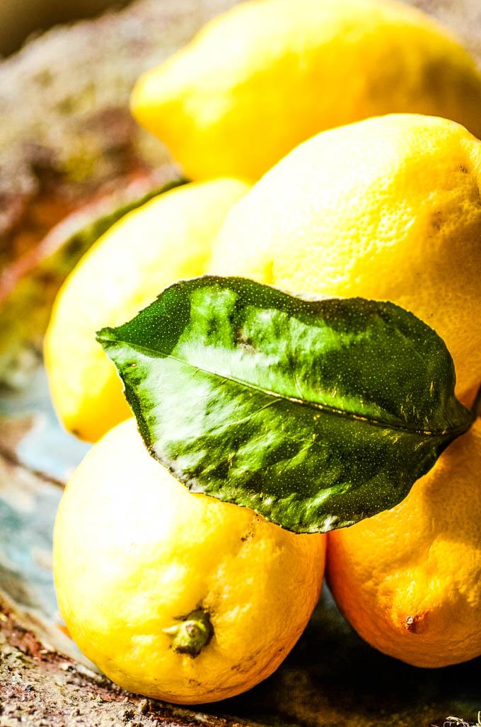 fresh lemons in blue bowl