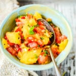 pineapple salsa close up of bowl with spoon