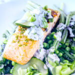 seared salmon on a bed of minted green vegetables
