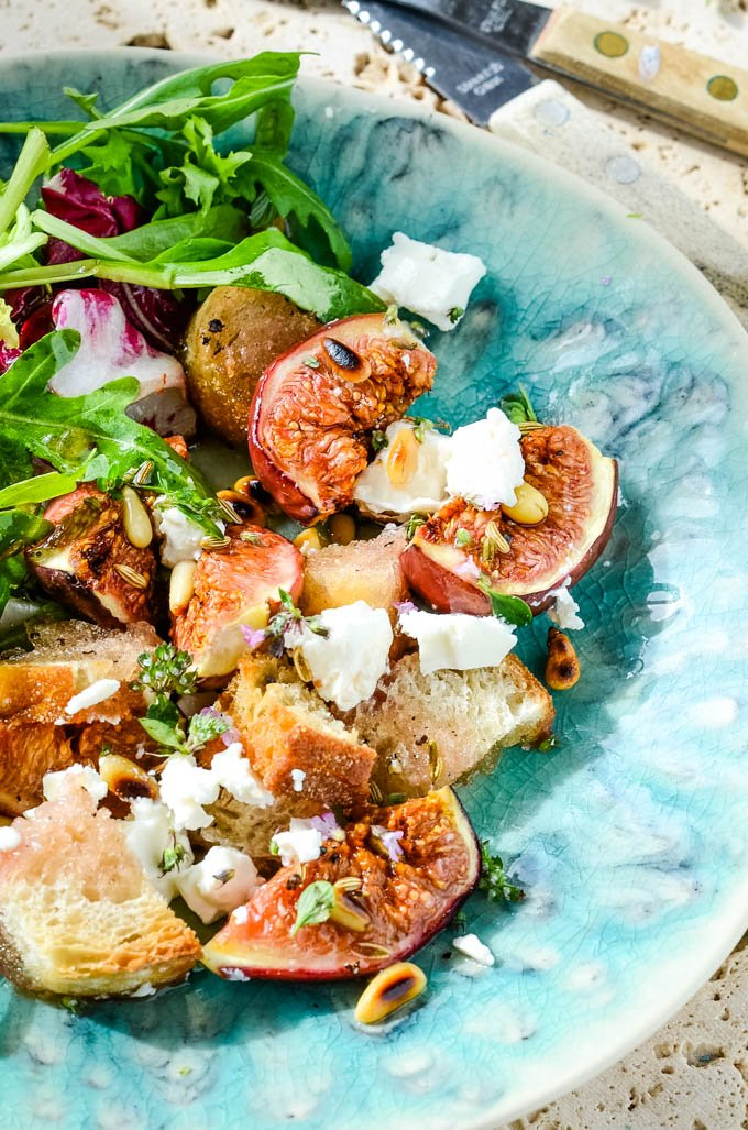 fig and feta salad with pine nuts on plate