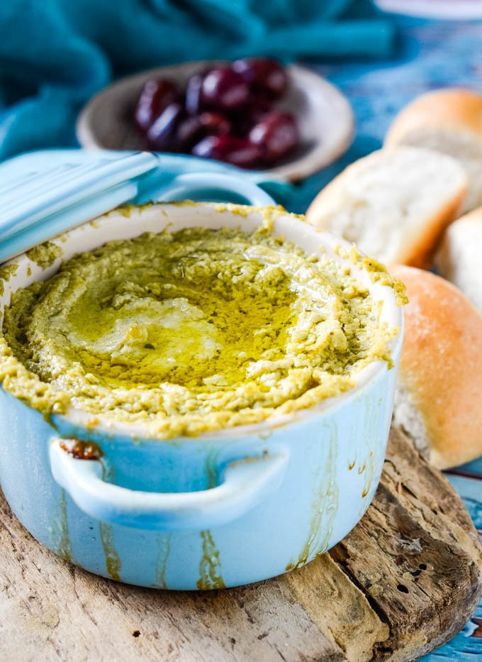 warm baked artichoke dip in blue pot