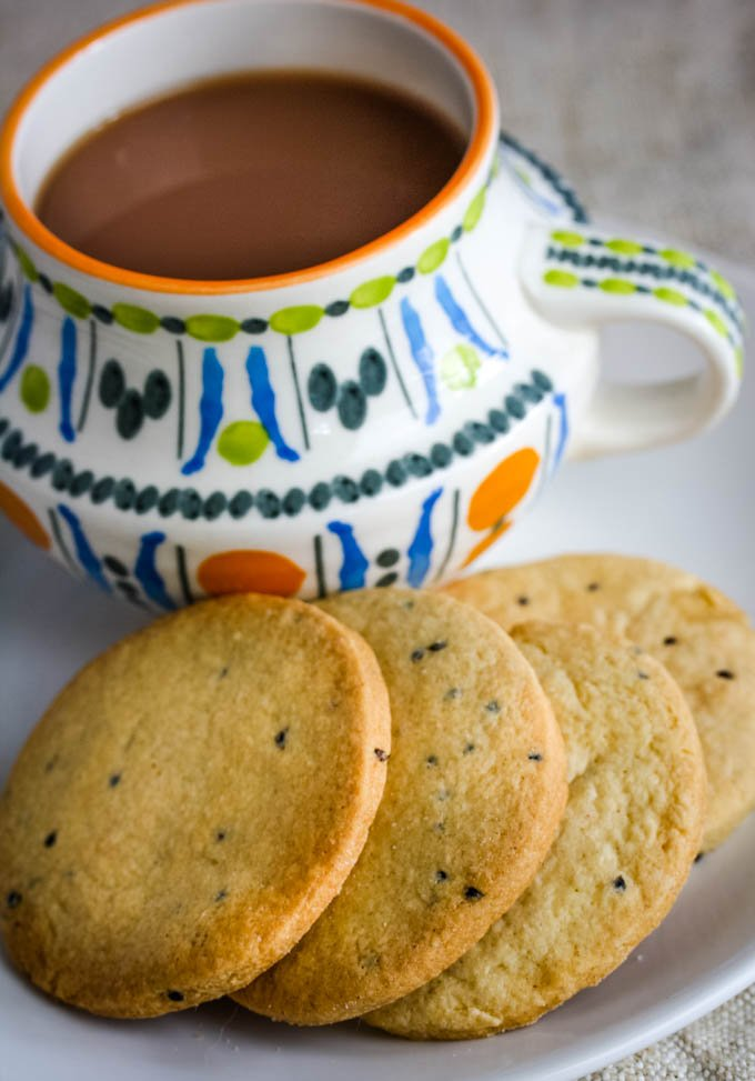 cup at an angle nwith cookies in front