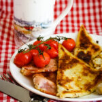 breakfast table with potato scones and bacon