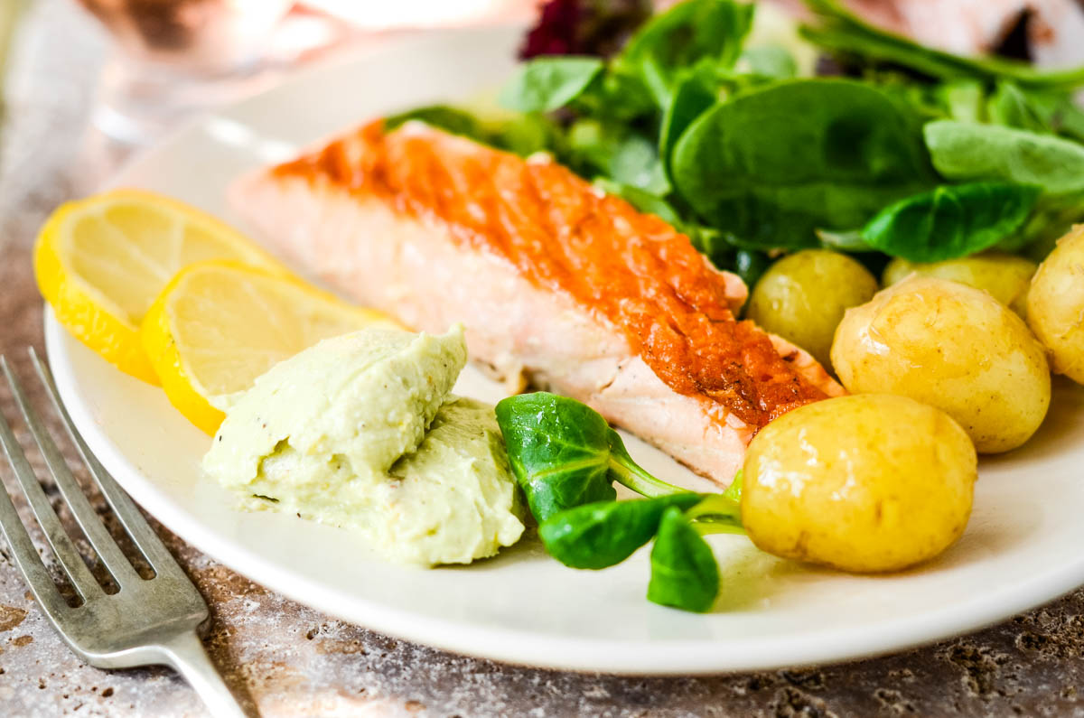 full shot of dip with seared salmon, salad and potatoes