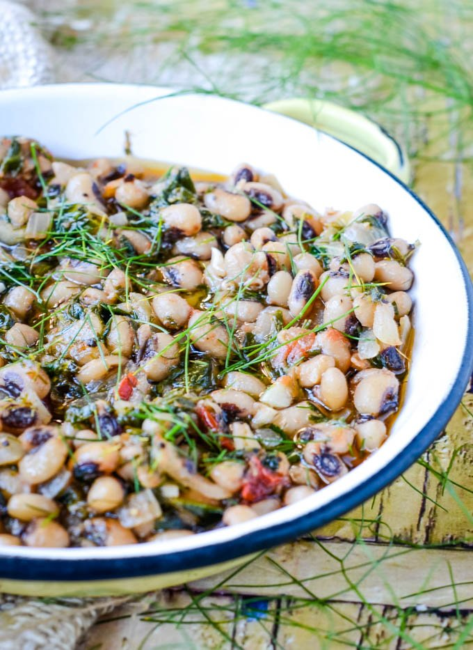 black eyed beans with spinach and fennel in baking dish