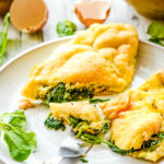 kale and spinach souffle omelette with fork on plate