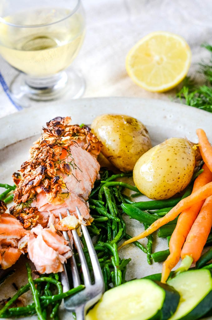 plate of baked salmon with fork