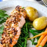 oat crusted salmon with boiled potatoes and carrots