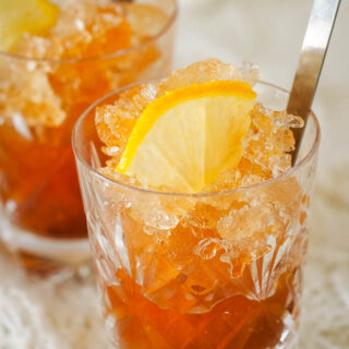 two glasses of whisky granita with lemon and spoons