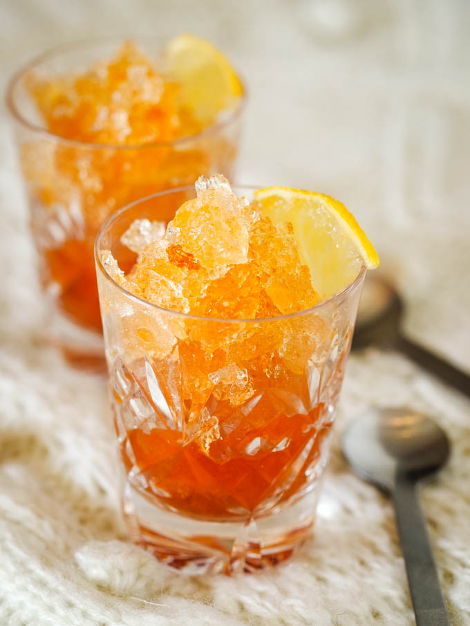 2 glasses of whisky granita with spoons at sides