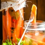 quick and easy pickled carrots in jar with pickle fork