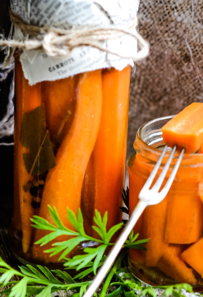 carrot on fork beside main jar