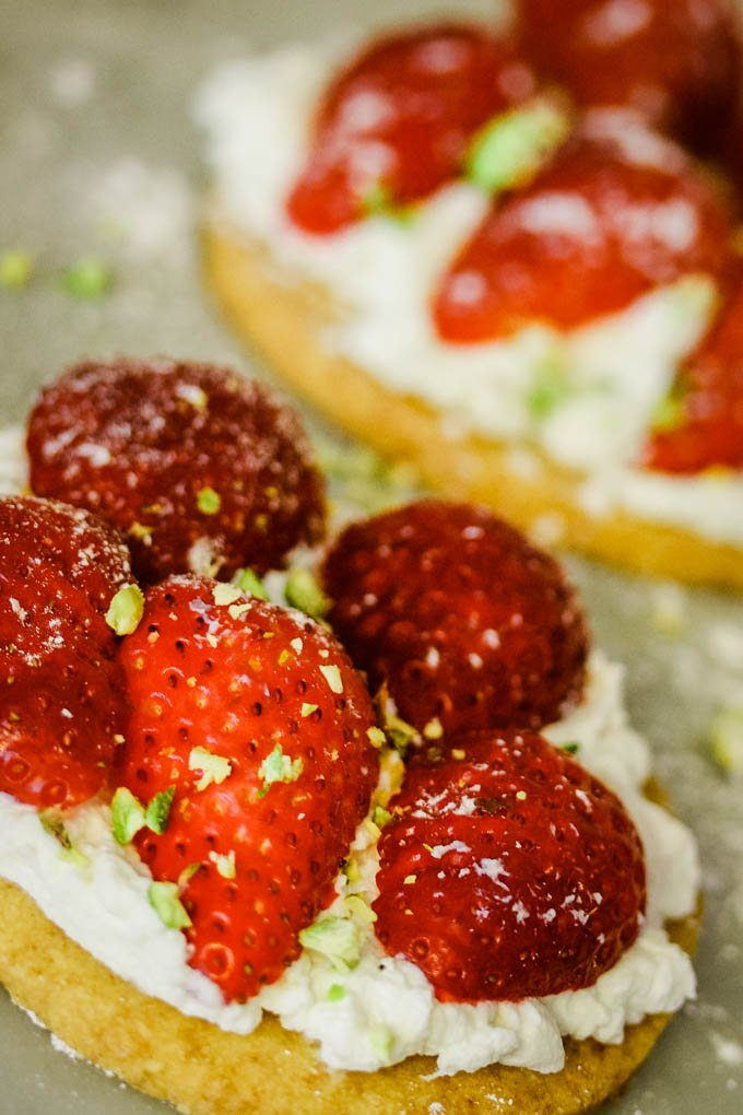 side view of shortcake covered in strawberries