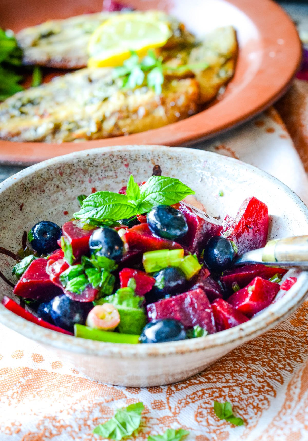 close up of the beetroot and blueberry salsa with sardines behind