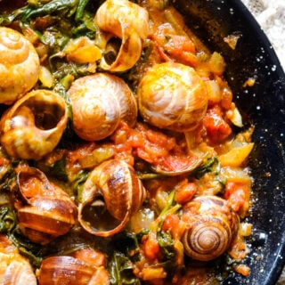 snails in pan cooking