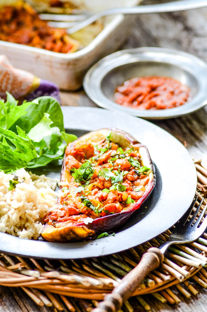 table shot with main dish and harissa