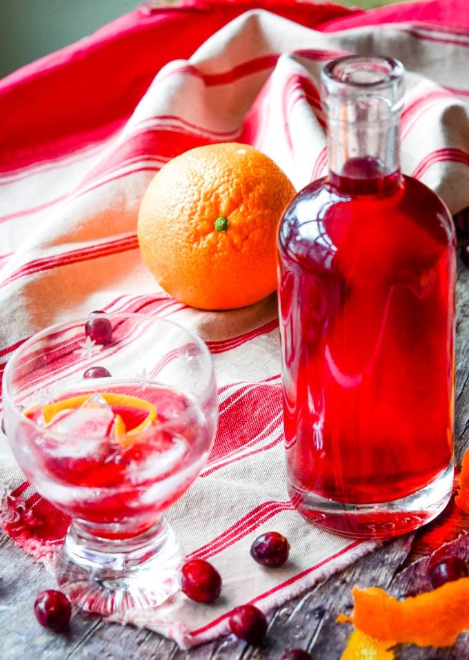 long shot showing orange drink and cranberries