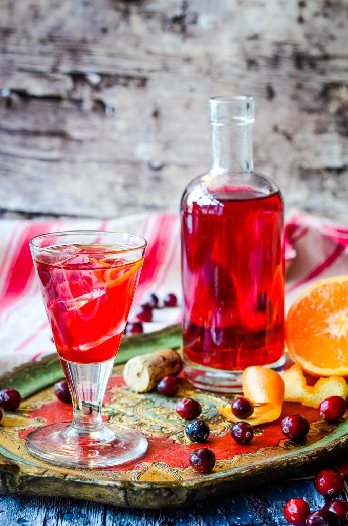 cranberry and orange gin liqueur bottle and glass
