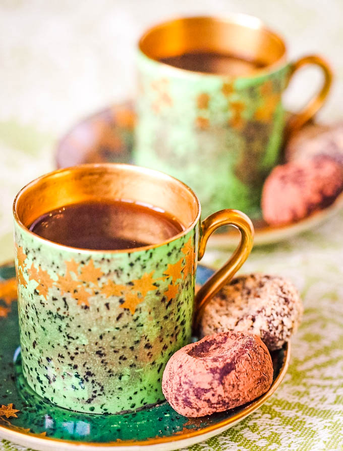 photo of two cups of coffee with truffles