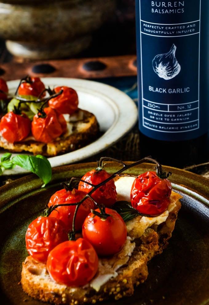 cherry tomato bruschetta with balsamic vinegar at side