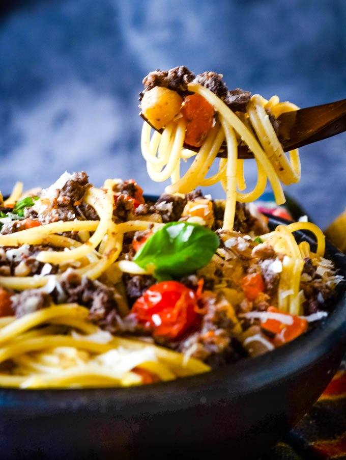 fork full of haggis above spaghetti