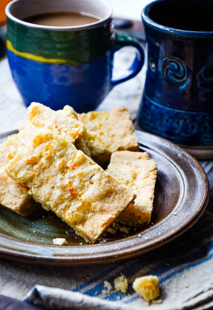 orange and caraway shortbread with mugs behind