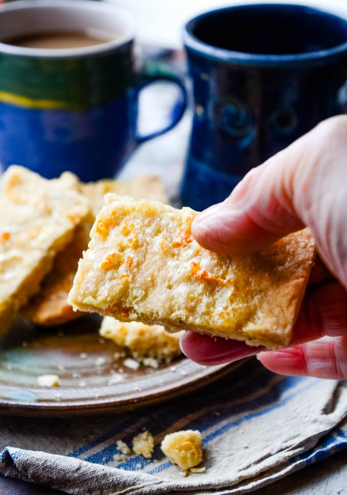 hand taking shortbread from plate