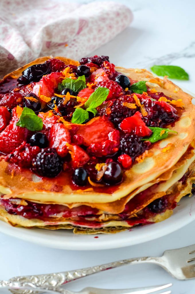 side view of pancake stack with berries on top