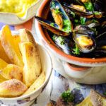moules frites with mayo in background