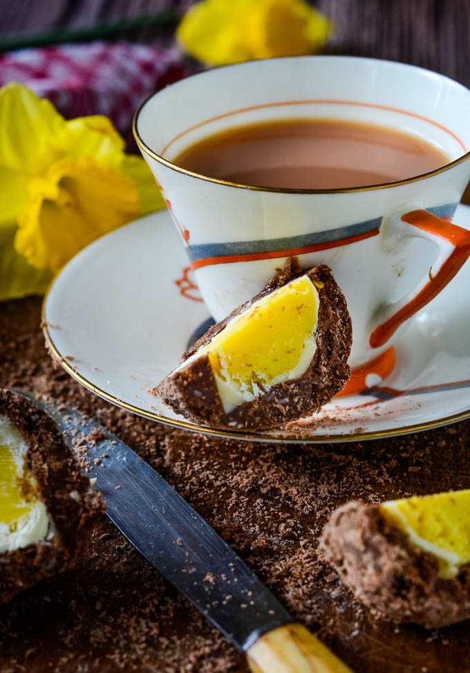 chocolate scotch egg with cup of tea