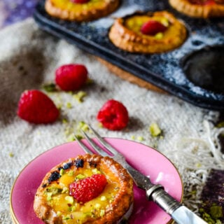 plate with single tart and raspberries