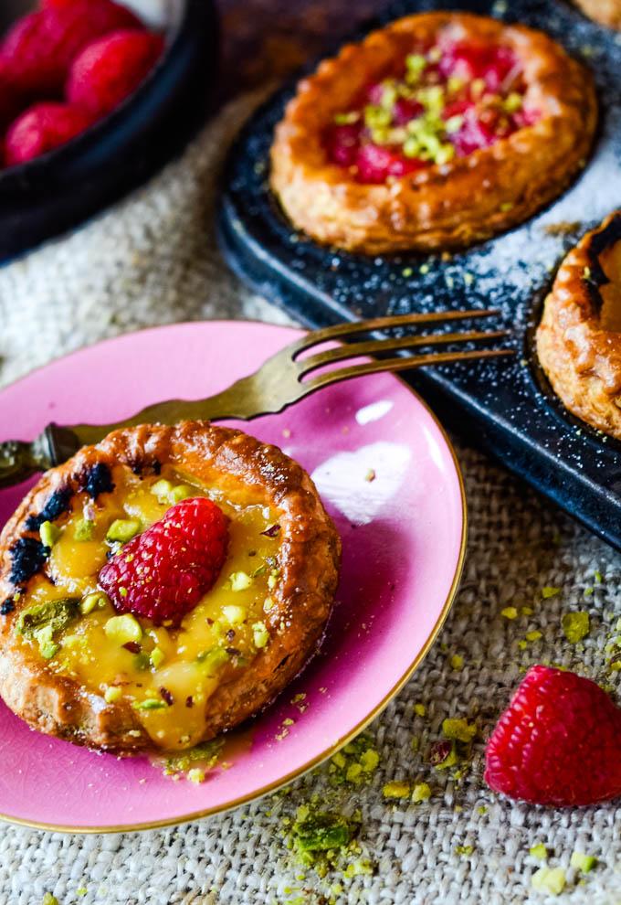 single tart with raspberry on top