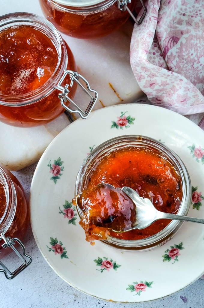 top down shot of jar of rhubarb jam on saucer