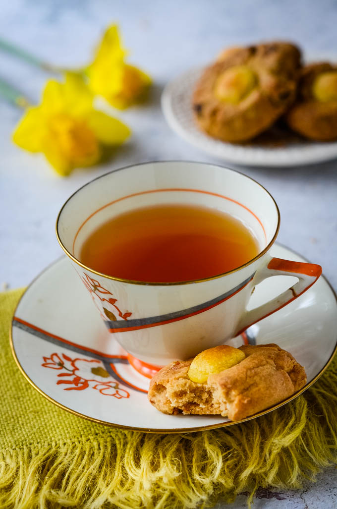cup of tea with cookie on saucer