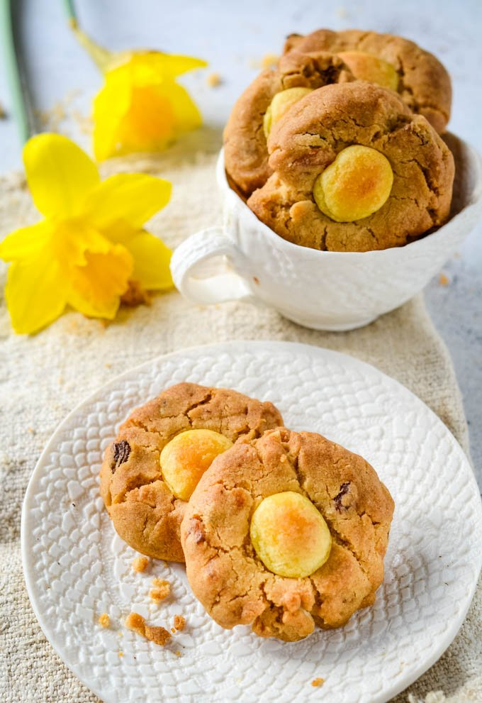 simnel cake cookies with daffodils and tea cup