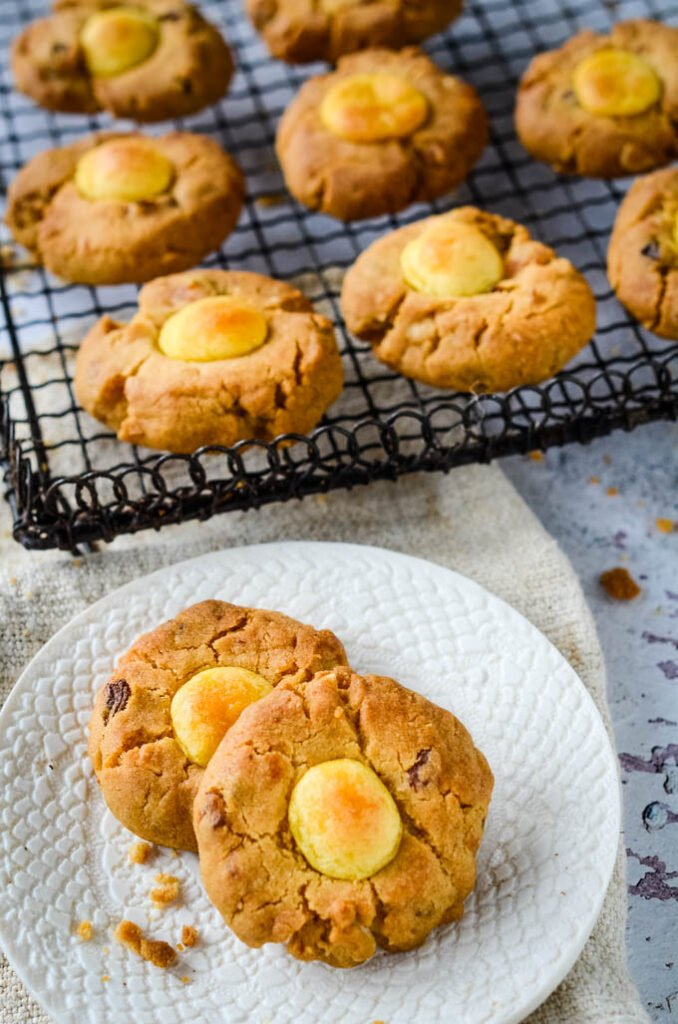 simnel cookies on saucer with cooling rack behind