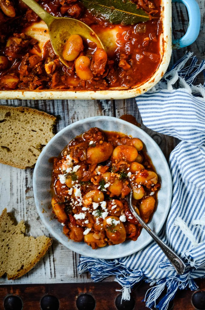 oven dish of beans and bowl of beans in front