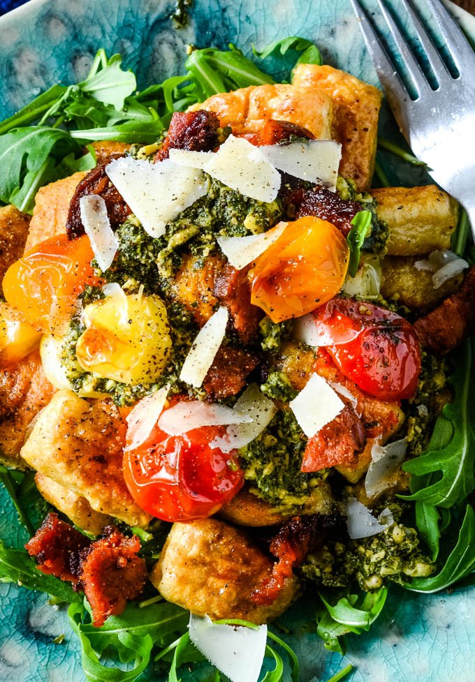 close u0 of plate of gnocchi with tomatoes