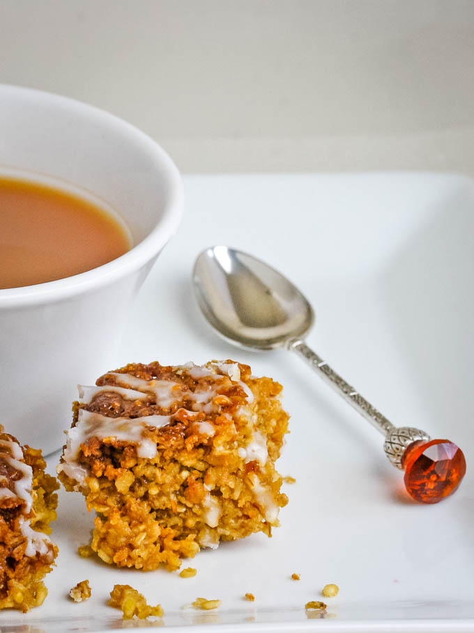 cup of tea with biscuit at side with spoon