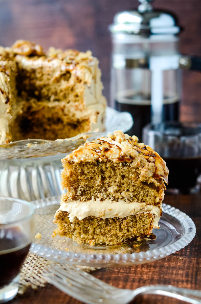 easy coffee and walnut cake with cardamom, slice of cake on small plate