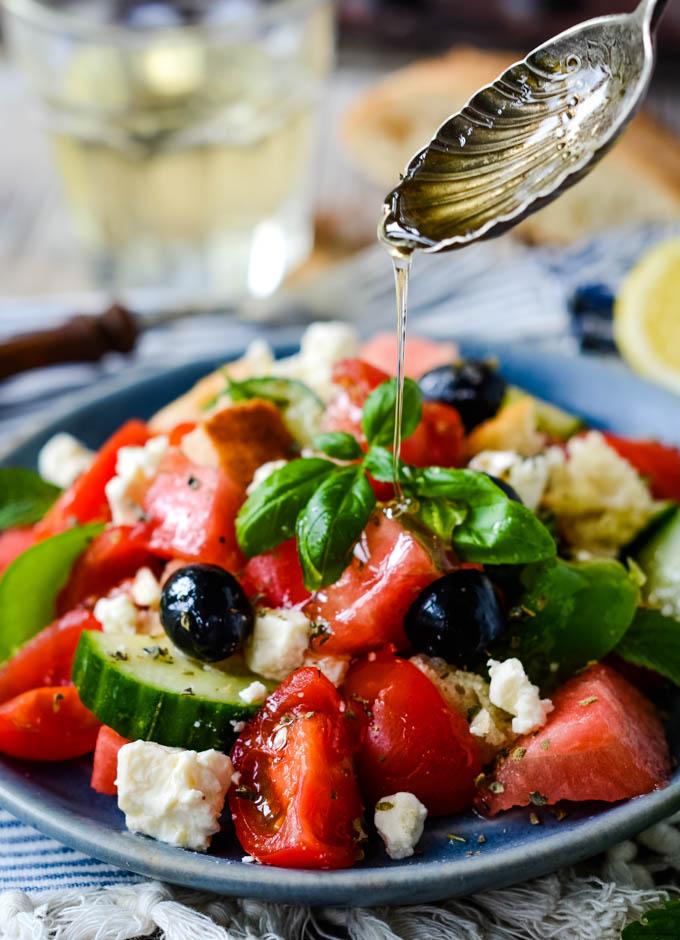 spooning honey into salad