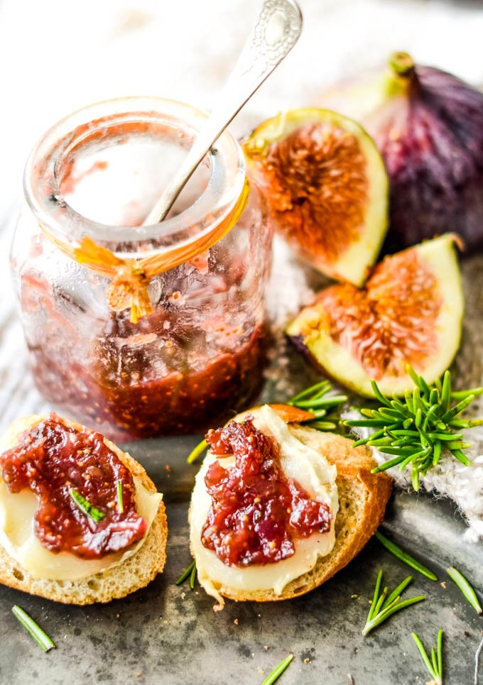 top down shot of jar, figs and toasts