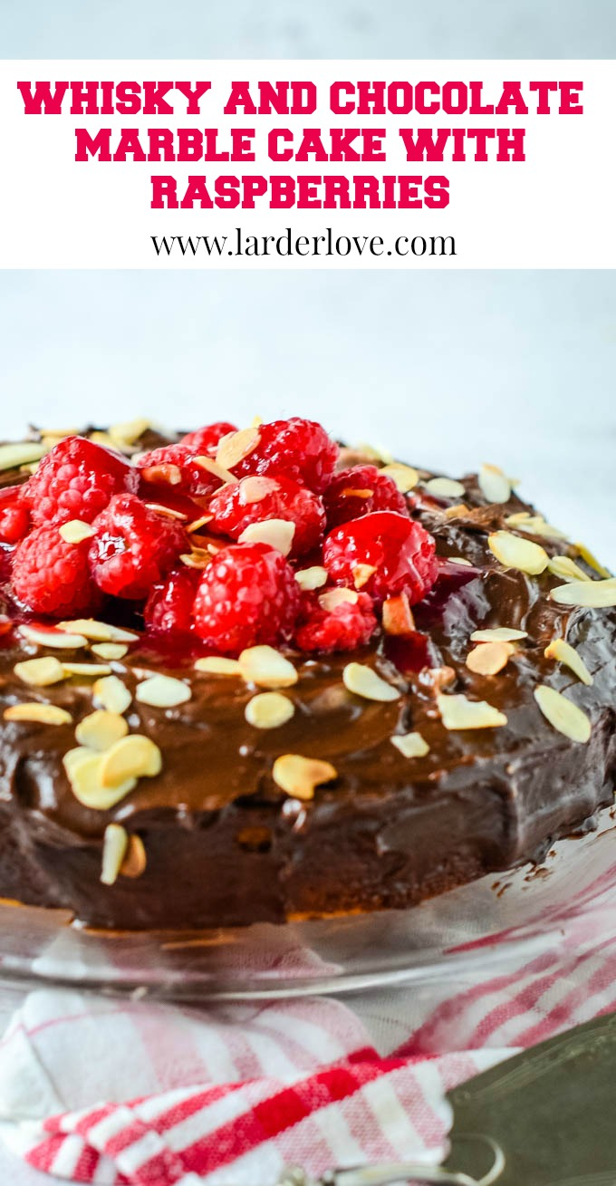 super easy whisky and chocolate marble cake with raspberries pin image
