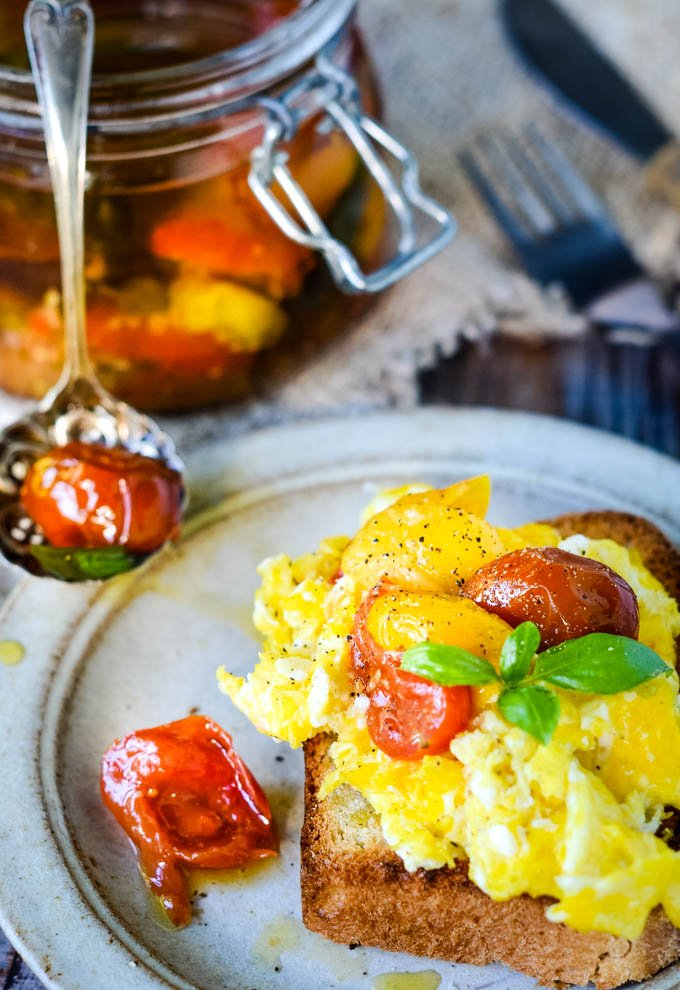 confit tomatoes on scrambled eggs on toast