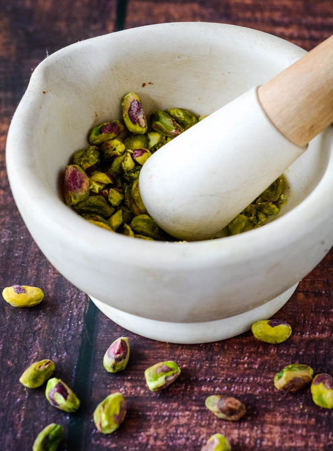 pestle and mortar with pistachios