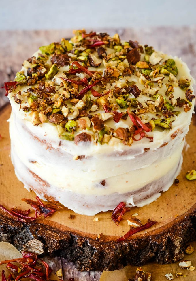 topping the cake with nuts and apple peel