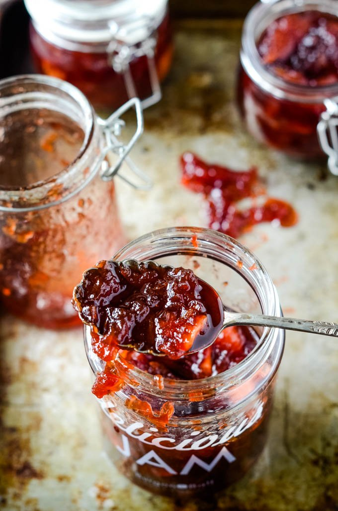 group of jam jars and spoon on top
