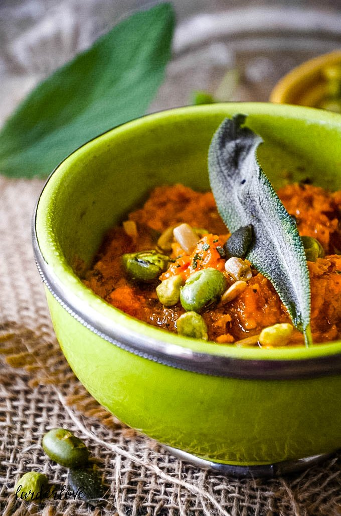 close up of hummus in bowl