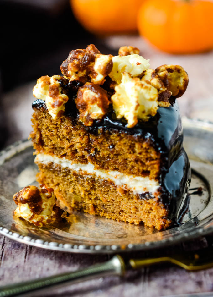 cake with pumpkins behind